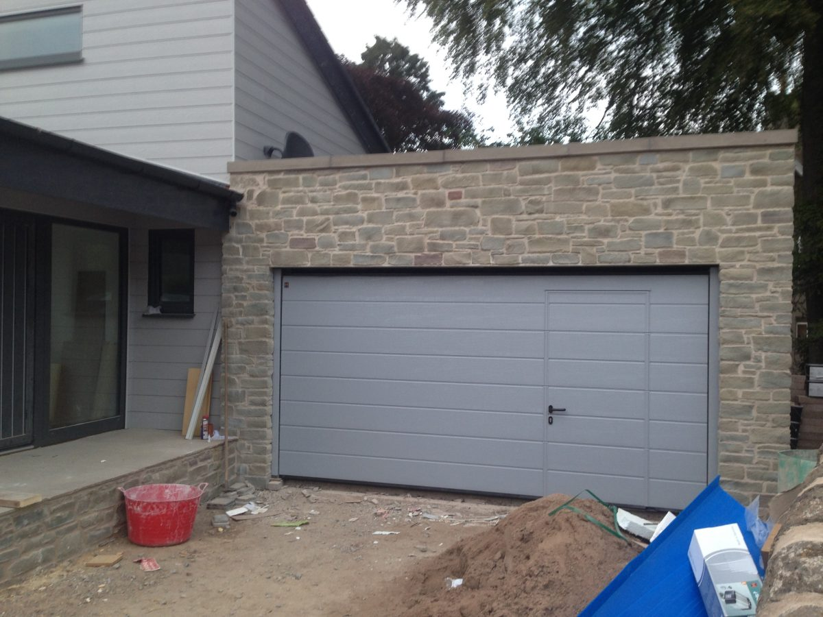 Sectional garage doors supplied fitted tayside garage doors hormann m ribbed sectional woodgrain window grey with wicket rubansaba